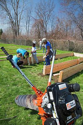 Volunteers Building Raised Beds Poster by Jim West