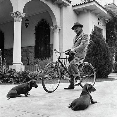 Waldemar Schroder On A Bicycle With Two Dogs Poster by Luis Lemus