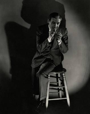 Walter Winchell Lighting A Cigarette Poster by Edward Steichen