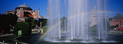 Water Fountain With A Rainbow In Front Poster