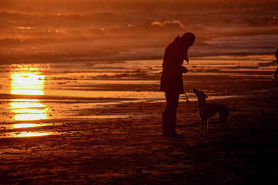 Woman And Dog  On The Beach  At Sunset Poster