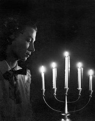 Woman And Menorah Poster by Underwood Archives