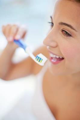 Woman Brushing Teeth Poster