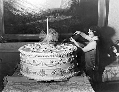 Woman Cuts 250 Pound Cake Poster by Underwood Archives