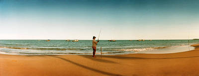 Woman Fishing On The Beach, Morro De Poster by Panoramic Images