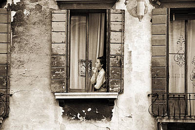 Woman Gazing Out Of A Window Contemplating Poster