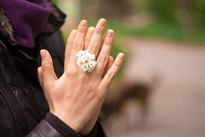 Woman Hands Together With Flower Ring Poster