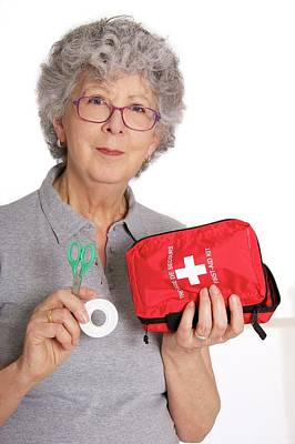 Woman Holding First Aid Kit Poster by Lea Paterson