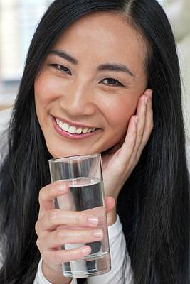 Woman Holding Glass Of Water Poster by Ian Hooton