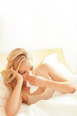 Woman In Bed Blowing Nose On Tissue Poster by Ian Hooton