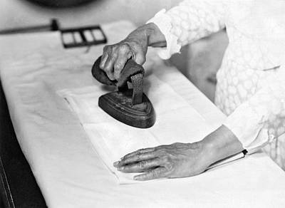 Woman Ironing With Flat Iron Poster by Underwood Archives