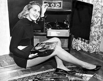 Woman Listening To Records Poster by Underwood Archives