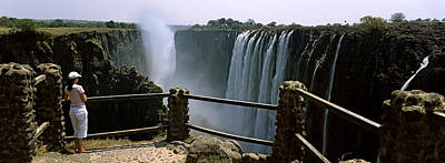 Woman Looking At The Victoria Falls Poster