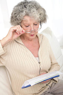 Woman Reading A Document Poster
