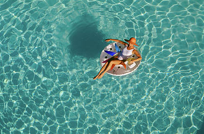 Woman Sitting On Float In Swimming Pool Poster