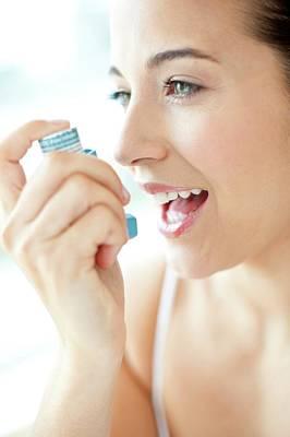 Woman Using An Inhaler Poster