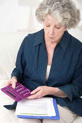 Woman Using Calculator Poster