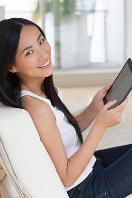 Woman Using Digital Tablet Poster