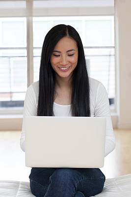 Woman Using Laptop Poster