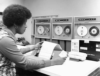 Woman Using Tape Drive Poster