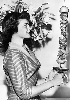 Woman With Shish-kebab Skewer Poster