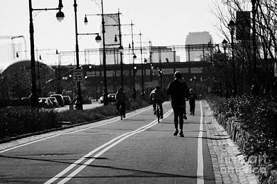women running and men cycling exercising on bikeway next to West Side Highway new york Poster by Joe Fox