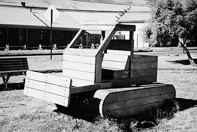 wooden bulldozer in a childrens play area with grafitti star of david scraped onto the side Punta Arenas Chile Poster by Joe Fox