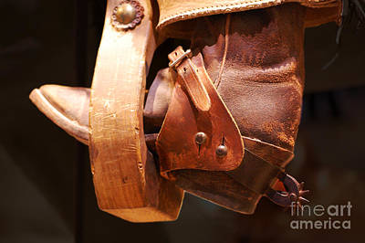 Worn Western Leather Boot With Spur In Stirrup Poster