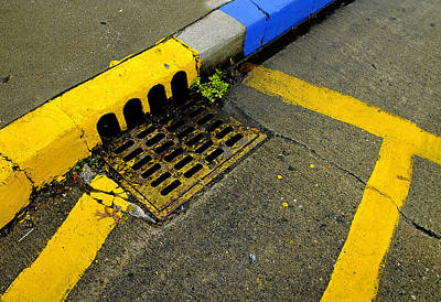 Yellow Lines And Sewer Grate On Street Poster
