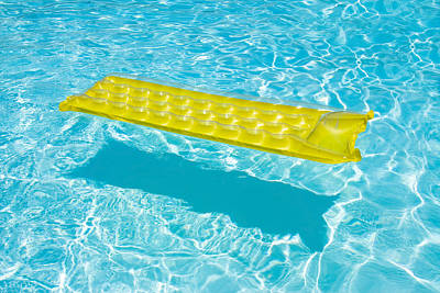 Yellow Raft Floating In A Pool Poster