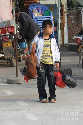Young Boy Carrying A Dead Chicken To School Poster