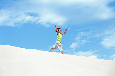 Young Boy Running On Sand Dunes Poster