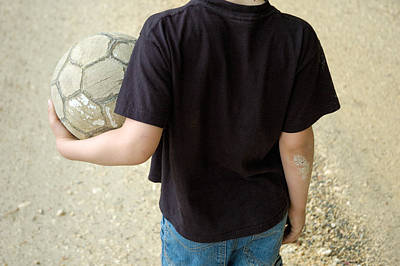 Young Boy With Soccer Ball Poster