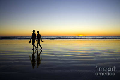Young Couple Walking On Romantic Beach At Sunset Poster by Colin and Linda McKie