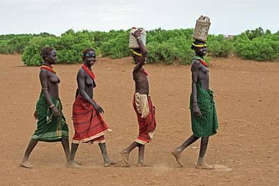 Young Dassenech Girls Carrying Water Poster