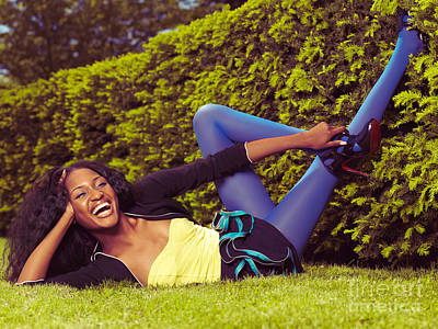 Young Happy Black Woman Lying On The Grass Poster