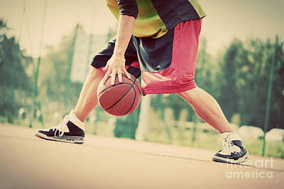 Young Man On Basketball Court Dribbling With Ball Poster