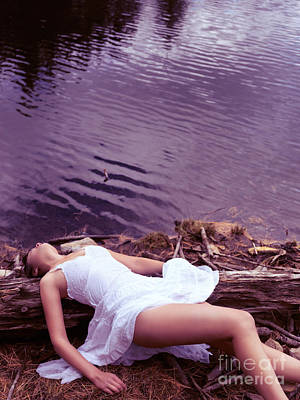 Young Woman In White Dress Lying Near Lake Poster by Oleksiy Maksymenko