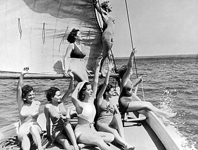 Young Women On A Sailboat. Poster by Underwood Archives