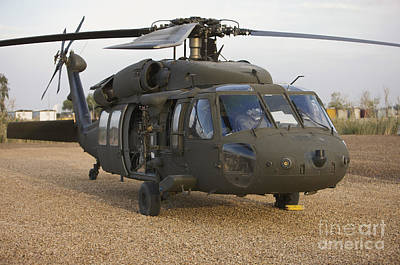 A Uh-60l Black Hawk With Twin M240g Poster by Terry Moore