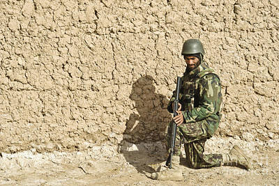 An Afghan Soldier Provides Security Poster by Stocktrek Images