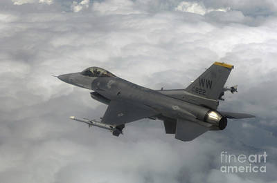 An F-16 Fighting Falcon In Flight Poster by Stocktrek Images