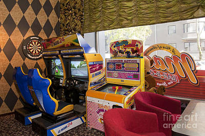 Arcade Game Machines At A Diner Poster