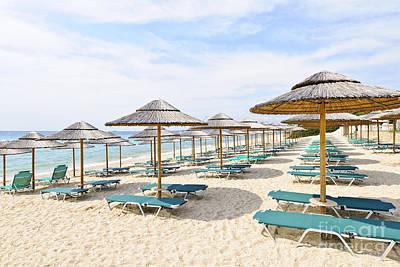 Beach Umbrellas On Sandy Seashore Poster by Elena Elisseeva
