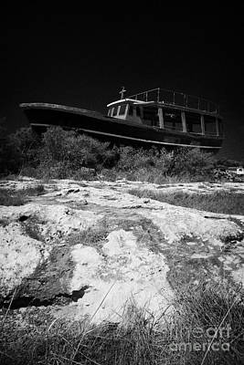 Beached Abandoned Fishing Boat In Potamos Typical Small Unspoilt Fishing Village Republic Of Cyprus  Poster by Joe Fox