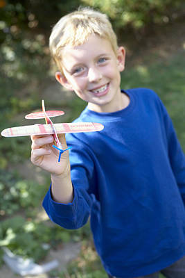 Boy Playing With A Toy Aeroplane Poster by Ian Boddy