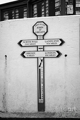 distance signs at the first and last shop John OGroats scotland uk Poster