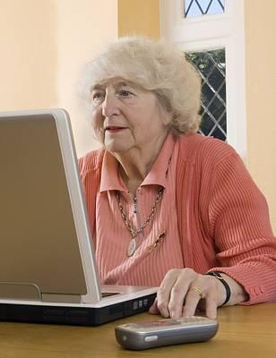Elderly Woman Using A Laptop Computer Poster