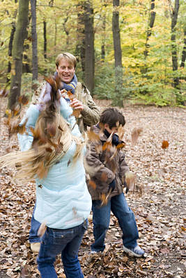 Father And Children Playing In A Wood Poster