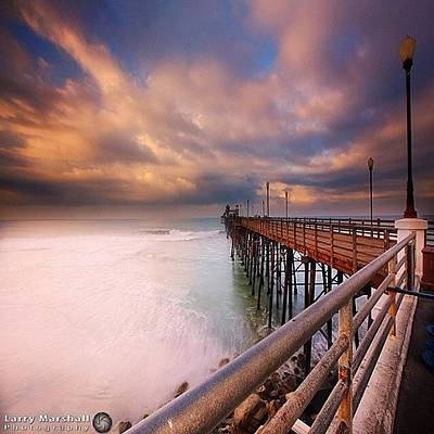 Long Exposure Sunset At The Oceanside Poster by Larry Marshall